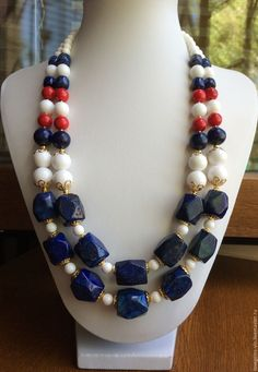 Materials: natural stones, lapis lazuli, agate, coral, gilded fittings Size: The length of the necklace is 55 cm in inner diameter, lapis lazuli (faceted pieces) - 18-16х14-15 mm, agate (smooth ball) - 12, 10, 6 mm, coral - 10 m