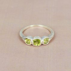 ONE BY ONE PERIDOT RING