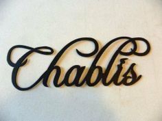 """Chablis Wine Word Metal Wall Art Home Kitchen Decor by JNJ Metalworks. $14.99. Hand Made in the USA. High Quality 16 Gauge Steel Construction. We do custom orders. Contact us today for details.. We can create words, names, logos and photos in metal.. Save $ when you buy multiple items. Check our promo's.. Metal Wall Art Decor Chablis Wine Word, Made Of High Quality Steel Very Sturdy, Painted Black, In New Condition, Chablis Measures 11 1/4"""" Long By 4 """" Tall. Be sure to..."""