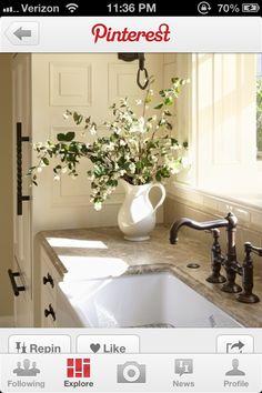 Fresh flowers by kitchen sink