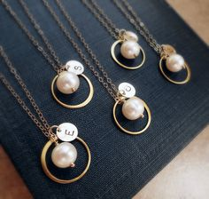Personalized Bridesmaids Eternity Necklaces, Pearl & Initial necklaces,Bridesmaid gifts... I like them in silver ;)