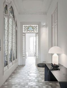 Rustic hex tiles in a Barcelona flat by Elina Vila and Agnès Blanch of studio Minim. Photo by C. Schaulin.