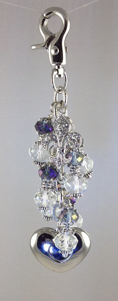 Purple metallic & clear beads are really eye catching on this purse light by Diva Dangles at www.divadangles.com