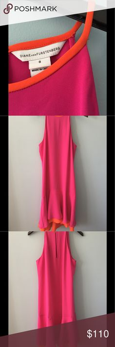 NWT DVF Kera Dress Stunning and hard to find - crepe - bright pink w/ orange contrast trim - grecian neckline - keyhole back - shift silhouette - dropped waist - tiered flounce hem - NWT - small (looks like deodorant) stain on hem - small picks close to arm opening on front - two small discoloration/stains on front - see pictures - price reflects imperfections Diane von Furstenberg Dresses Midi
