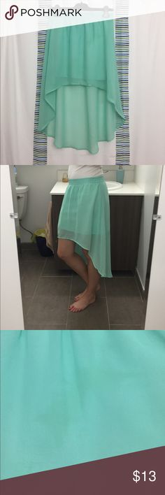 Seafoam Hi-Lo Skirt Cute polyester hi-lo skirt. Super flowy and airy, great for summer 🌺🌸. Slight oil stain on the front that I tried to picture...but it's very faint so it's barely noticeable when wearing. I usually wear a small but I got this in medium so it would sit on my hips. Has a mini skirt lining so it is not sheer! :) tags: beach coverup spring pastel swim vacation boho Skirts High Low