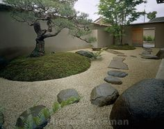 """Entitled """"Abstraction Garden"""" by its designer, an sculptor and potter Kazumasa Ohira, this arragement of stones and gravel, flanked by two opposing trees, is a study in focused composition. At the centre is a ceramic water vessel, smaler than the other elements, but ultimately the strongest feature. Kibugawa. Japan"""
