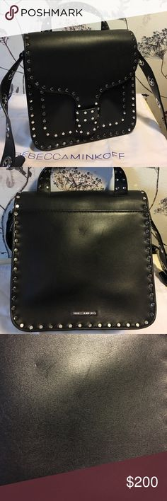 Rebecca Minkoff Midnighter Top Handle Feed Bag Black with silver toned hardware.  Adjustable crossbody.  Only used a few times.  Great condition, but does have some surface marks here and there on the leather because of its softness.  Includes original dust bag. Rebecca Minkoff Bags Crossbody Bags