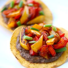Roasted Bell Pepper Tostada: black bean puree, roasted red and yellow peppers, and scallions. Vegan deliciousness.