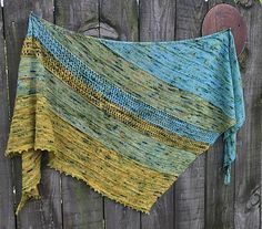 """A simple to knit asymetrical shawl inspired by Waterton-Glacier National Parks in Alberta, Canada and Montana, United States. This shawl was created to be accesible to all levels of knitters and inspired by the """"International Peace Park,"""" a union of both National Parks that occurred in 1932 as a symbol of peace. The United Nations recognizes the International Peace Park as a World Heritage Site."""