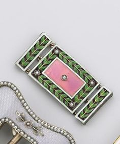 A Fabergé gold-mounted guilloché enamel neck ornament, workmaster August Holmström, St. Petersburg, 1908-1917, the translucent pink rectangular central panel enamelled over guilloché sunburst ground set with central seed pearl, the rim formed by chased translucent leaves with further seed pearls at the corners framed by white guilloché borders, flanked by two panels repeating the foliate motif, the central panel with engraved floral motif to reverse.