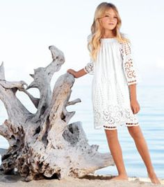 wisteria eyelet dress - A girl is sure to feel beautiful in this ethereal style. Floral eyelet fabric borders the hem and makes up the bell sleeves, floating over a gauzy lining. The shirred neckline adds a romantic touch.