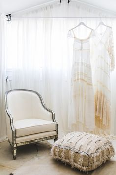 Bright boho retail space with a cream armchair