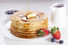 Delicious sweet American pancakes on a plate with fresh fruits stock photo © Majk Roze (BrunoWeltmann) (