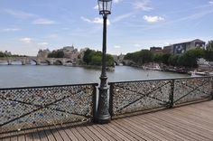 The Pont des Arts bridge in Paris. For years, visitors have been attaching locks with sentimental messages to the bridge in symbolic acts of affection. Some further seal the deal by throwing keys into the Seine River below. #Paris #France #PontDesArts #Seine #Love
