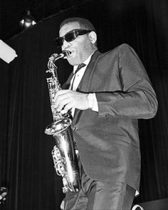 Ray Charles playing his alto at a concert in France, c. 1963; Hank Crawford left (Gamma Keystone/Getty).