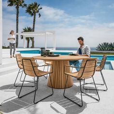 Gloster William Dining Chair with Arms Wood and metal outdoor dining chairs give a clean contemporary feel