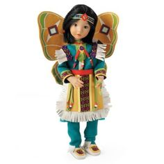 Native American-inspired child doll by Dianna Effner has rotating joints that allow her to convey expressive dance moves. Colorful costume.