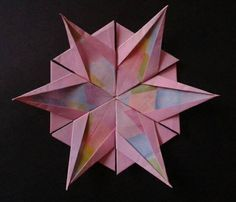 Origami snowflake Video tutorial here http://www.youtube.com/watch?v=uaKoGtTJN8g#t=15