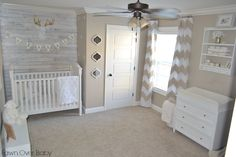 We can't get enough of this white-washed pallet wall in this rustic chic neutral nursery! {designed by @Fawn Gehweiler Over Baby} #nursery #neutral