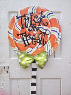 Halloween lollipop door hanger.  Free personalization with the greeting of your choice!