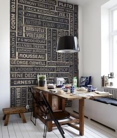 Love this!  Instead of a plain painted wall, adding collections of  theme is neat.  Tapping off chalkboard paint designs is cool so you can change the words.  A literature lover's room.