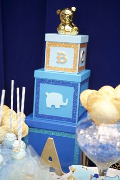 Custom made baby boxes to go with the different shades of blue for baby shower. Baby boy on the way! Blue and gold themed baby shower. | Lovelyfest Event Design | Royal Blue Baby Shower