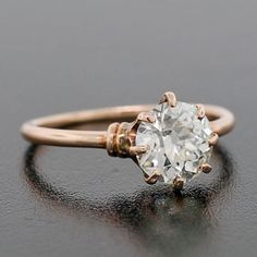 love the band that is rose color.. A Brandt and Son - Victorian 18kt Rose Diamond Engagement Ring 1.29ct