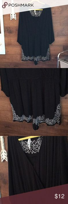 Black & white Romper 3/4 sleeve XL Romper with white floral stitching design on shorts and back.  Measures 35 inches long.  100% Rayon.  Light weight.  Great for casual wear or dressing it up with some heels.  Bust measures 20 inches across. Bethany Mota Shorts