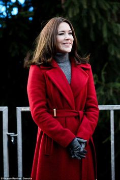 Festive: Crown Princess Mary dressed for the occasion in a red coat for the Christmas Tree Lighting ceremony in Copenhagen on Sunday