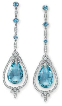 A PAIR OF DIAMOND AND AQUAMARINE EAR PENDANTS, BY TIFFANY & CO. Each suspending a faceted aquamarine briolette drop, swinging within a circular-cut diamond frame of foliate motif, from a circular-cut diamond chain, spaced by a collet-set and square-cut aquamarine, to the collet-set aquamarine surmount, mounted in platinum