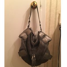 Pewter Bag no name brand. nice shoulder bad. gray lining. two small inside pockets and a zip pocket. great condition. Bags Shoulder Bags