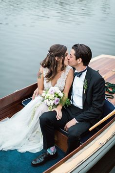 bride and groom arrival by boat / photo by Brooke Images