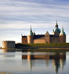 Kalmar slott (Kalmar Castle)  Småland in Sweden....     http://www.castlesandmanorhouses.com/photos.htm   ...      During the twelfth century the round defensive tower (on the left) was built on Kalmarsund and a harbour constructed here. At the end of the thirteenth century King Magnus Ladulås had a new fortress built  with a curtain wall, round corner towers and two square gatehouses.