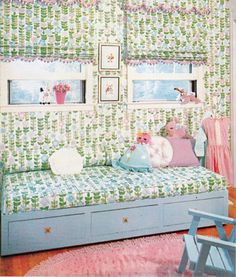 A fantastic vintage girls bedroom with a pale blue day bed... with amazing blue, green, lilac fabric on the windows and bed. With a fuzzy pink carpet...