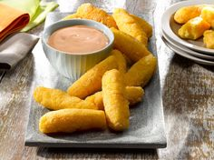 Surullitos are fried corn sticks that are wildly popular appetizer food in Puerto Rico. In this authentic surullitos recipe, a quick, homemade cornmeal dough is mixed with cheese, rolled into cigar shapes and fried. Puerto Rican Dishes, Puerto Rican Cuisine, Puerto Rican Recipes, Cuban Recipes, Goya Recipes Puerto Rico, Cuban Cuisine, Steak Recipes, Boricua Recipes, Comida Boricua