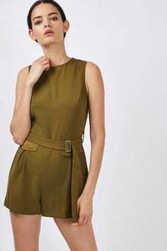 Add instant cool to your look in this utility playsuit in khaki. Featuring satin pocket detail and an adjustable waist belt. Style with black mules for an on trend ensemble. #Topshop