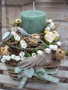 Eggs, Flowers, and Candle in Easter Basket