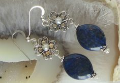 These lovely deep blue Lapis Lazuli gemstones look beautiful, dangling from handmade Bali sterling silver filigree drops, which themselves are