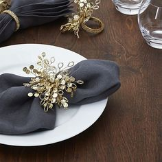 An intricate play of soft gold beads and sequins creates a flurry of festive visual interest to dress up the holiday table.