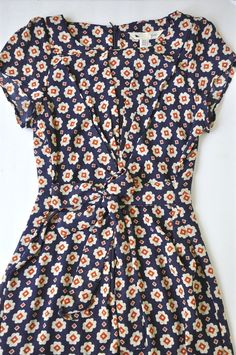 Stitch fix Yumi Faris Floral Print Cap Sleeve Dress -- The print is adorable and the cut/shape look awesome. Looks like a perfect dress.