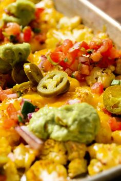 These Low-Carb Cauliflower Nachos Taste Like Cheat-Day Food  - Delish.com. Maybe low fat cheese and some fresh veggies and guacamole?