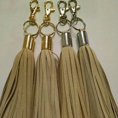 CREAM/NUDE Tassel Add more glance to your favorite purse,wallets,clutch,and key rings with this 100% leather  tassels available  in gold and silver hardware  more colors available  please check my listing. Michael Kors Bags