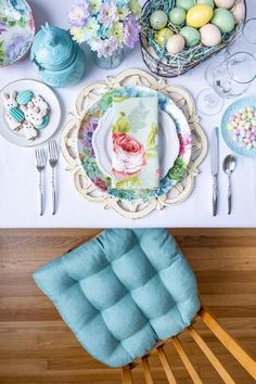 Easter Floral Table Setting Featuring Our Hayden Turquoise Aqua Dining Chair Cushion with Ties. These linen look chair cushions are not only elegant but also machine washable. Brighten up your coastal beach house or add a pop of aqua to your traditional dining room. Our chair pads are made in the USA by Barnett Home Decor and latex foam filled so they will not go flat. Teal Upholstery Fabric, Fabric Decor, Turquoise Dining Chairs, Dining Chair Cushions, Egg Hunt, Outdoor Fabric, Home Decor Items, Decorative Plates, Aqua
