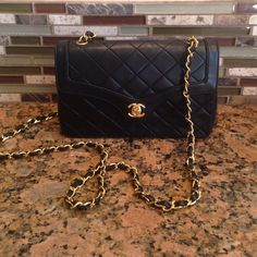 Vintage Chanel Lamb skin. Gold hardware. Single strap.excellent condition. Dust bag included. Approximately 8 1/2 inches long and 5 1/2 inches tall. CHANEL Bags Shoulder Bags