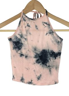 - tie dye pattern - quartz pink and black color - halter neck - crop top - hand wash - 95% rayon and 5% spandex - made in USA