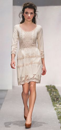 Ivory dress with stretch slim bodice, scoop neckline, and a-line skirt. Eyelet-inspired openwork and macramè inserts. By Luisa Beccaria 2012.