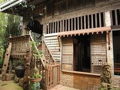 Traditional filipino house. Wonderful textures! Weathered wood & an airy first floor.