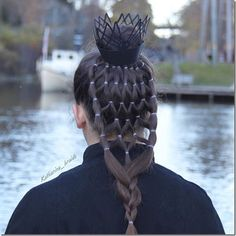 Spider bun and intricate elastic spider web hairstyle.   This looks so cool!!  I love it for Halloween or maybe even crazy hair day!