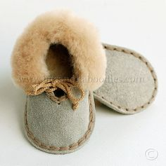 Cuddly little shoes made of genuine Soft Suede Leather and crocheted with 100% Wool Yarn. Have soft, sheespskin collar and replaceable sheepskin