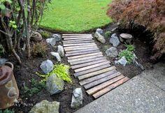 Make a pallet wood walkway for your garden :: Hometalk